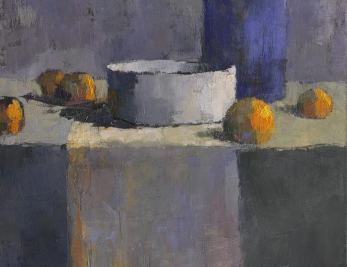 Blauwe vaas met sinaasappels